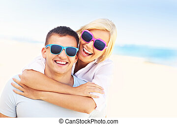 Joyful couple having fun at the beach