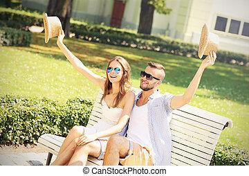 Joyful couple on a bench