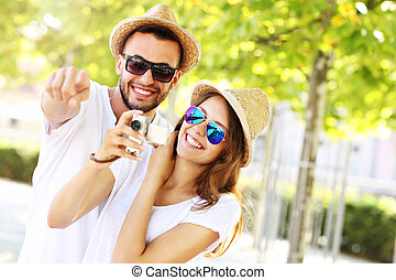 Joyful couple taking pictures in the city - A picture of a ...