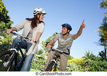 Joyful couple with their bikes