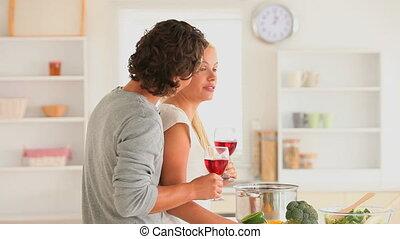 Joyful couple with wine