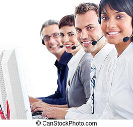 Joyful customer service representatives working at computers...