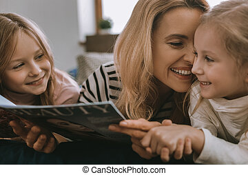 Joyful cute girls being with their mother