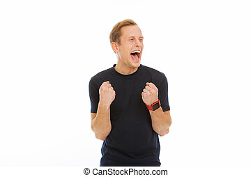 Joyful delighted man expressing his positive emotions