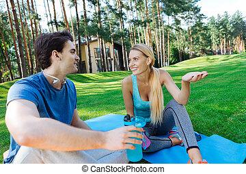 Joyful delighted people having a nice conversation
