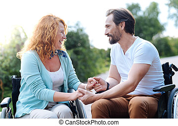 Joyful disabled couple spending time in the park