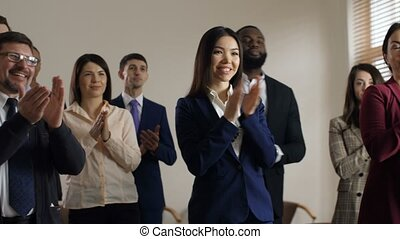Joyful diverse employees welcome executive manager - Smiling...