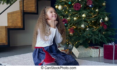 Joyful dreamy girl making a wish for christmas - Positive...
