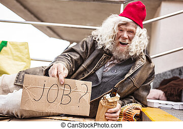 Joyful drunk man looking for a job