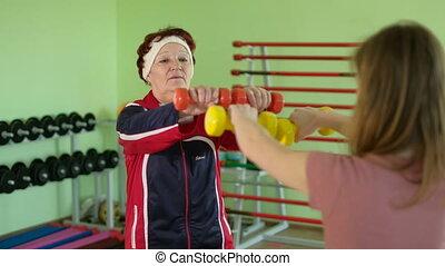 Joyful elderly woman having a fitness workout 4k