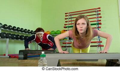 Joyful elderly woman having a fitness workout