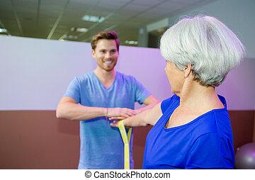 joyful elderly woman in a gym