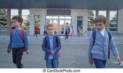 Joyful elementary age boys going from school - Cute ...