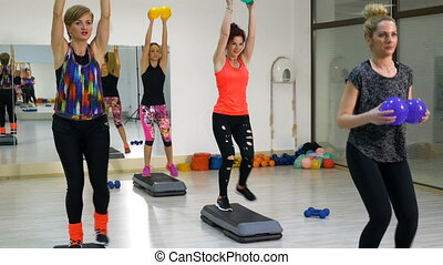 Joyful energetic group of women exercising for legs and arms