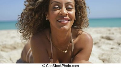 Joyful ethnic woman on shoreline - Pretty African-American...