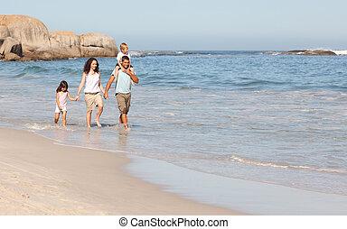 Joyful family at the beach