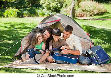 Joyful family camping