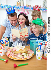 Joyful family celebrating mother\'s birthday