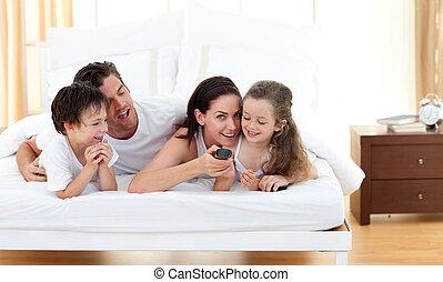 Joyful family having fun in the bedroom