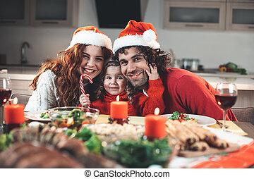 Joyful family having fun on New Year celebration