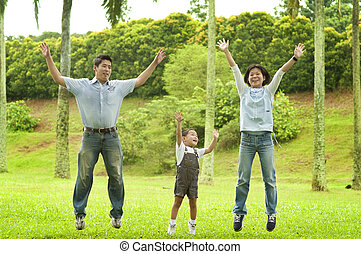 Joyful family jumping together