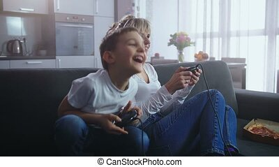Joyful family spending time playing video game