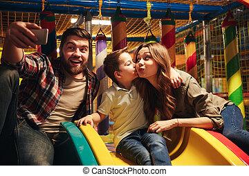 Joyful family with their little son