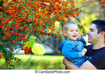 joyful father and son having fun, colorful nature