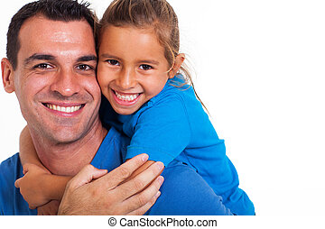 joyful father giving piggyback ride to his daughter