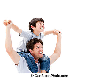 Joyful father giving piggyback ride to his son against a ...