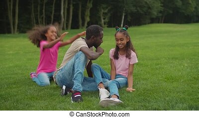 Joyful father with girls bonding in summer nature - ...