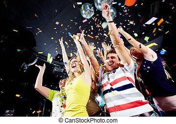 Joyful friends - Photo of excited teenagers in confetti...