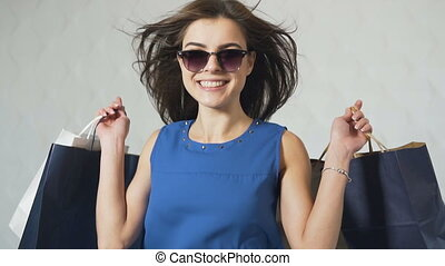Joyful Girl after Shopping - Joyful girl holding shopping...