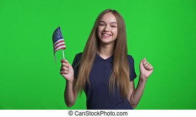 Joyful girl holding small USA flag celebrating triumph - ...
