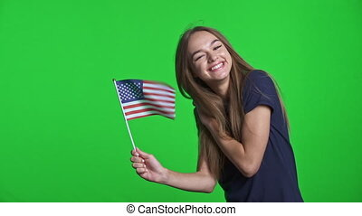 Joyful girl holding small USA flag celebrating triumph - ...