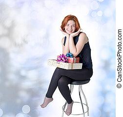 Joyful girl on a chair