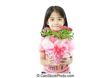 Joyful girl with flower pot