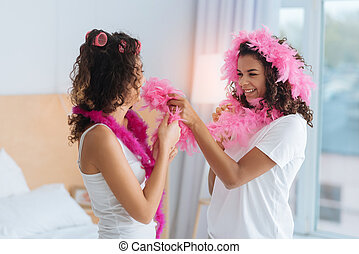 Joyful girls playing with pink feather boa - Never bored...