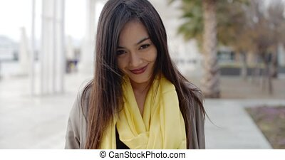 Joyful grinning woman outside in yellow scarf - Single...