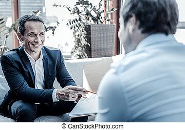 Joyful happy businessmen having a meeting