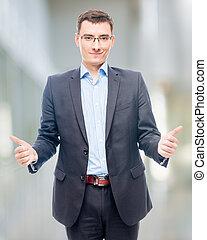 Joyful happy entrepreneur in office showing gesture with hands