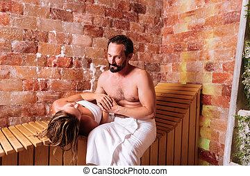 Joyful happy man being with his girlfriend in sauna