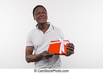 Joyful happy man showing the present