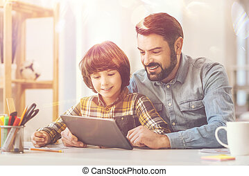 Joyful happy man spending time with his son