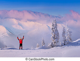 Joyful hiker meets a morning in the snowy mountains