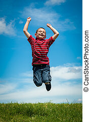 Joyful kid jumping happy