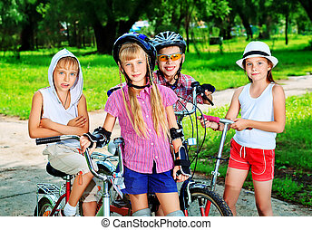 joyful kids - Group of active children in a summer park.