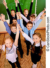 joyful kids - Happy schoolchildren at a classroom. Education...