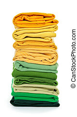 Pile of green and yellow folded clothes