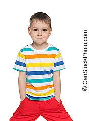 Joyful little boy in striped shirt